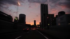 Wind shield glass first person pov heavy gray rain cloud in stunning evening sunset sky over busy traffic highway road. Wind shield glass car first person pov stock video footage