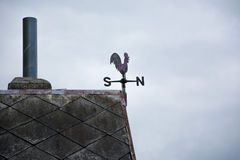 Wind signal cock on roof Stock Photos