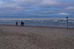 Wind and snow clouds over the Gulf of Riga in December stock image
