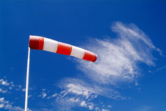Wind sock. A wind sock and cloudy sky in the background Royalty Free Stock Photo