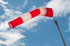 Wind sock. Air wind sock against blue sky pointing left Royalty Free Stock Photography