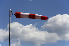 Wind sock and sky. Wind sock, cloud and sky Stock Image