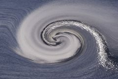 Wind and spray in a swirl Stock Image