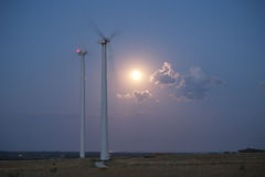 Wind station turbines and full moon Royalty Free Stock Image