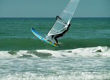 Wind surfer. Going out to sea on your surf board Royalty Free Stock Photo