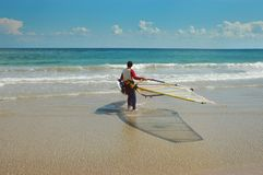 Wind surfer on beach stock images