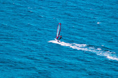 Wind surfer on blue sea Stock Images