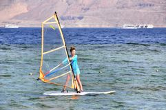 Wind Surfer Girl Stock Photos