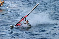 Wind surfer pulled by the sail. Wind surfer strongly pulled by the sail Stock Image