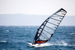 Wind Surfing. A wind surfer on the ocean Stock Image