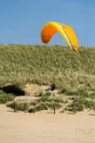 Wind surfing across the dunes Stock Image
