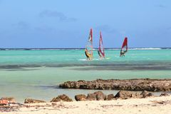 Kralendijk, Bonaire: 12/16/2017: Wind surfing on Sorobon Beach on the island of Bonaire. Wind surfing on Sorobon Beach on the Caribbean island of Bonaire royalty free stock images
