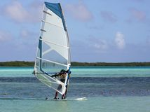 Wind surfing the tropics. Wind surfer on an ocean bay in the tropics Stock Images