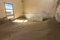 Wind swept sand in room. Kolmanskop Namibia Royalty Free Stock Photography