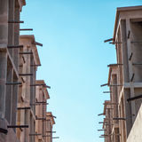 Wind towers in Dubai. Arabian Wind Towers on the top of a house in Dubai, United Arab Emirates. Wind Towers were used in the arab architecture to cool the Stock Photo