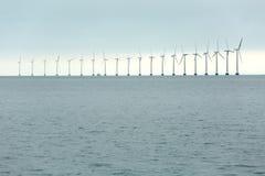 Wind tubines. Offshore wind turbines at the sea in Copenhagen, Denmark Royalty Free Stock Photo