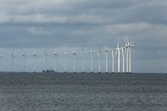 Wind tubines. Offshore wind turbines at the sea in Copenhagen, Denmark Stock Images