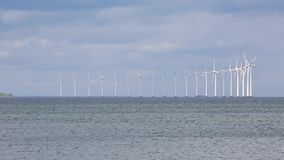 Wind tubines at sea stock footage