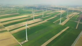 Wind tubines spinning, aerial footage stock video