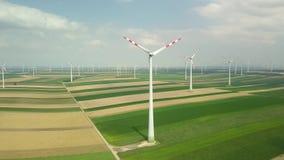 Wind tubines spinning, aerial footage stock video footage