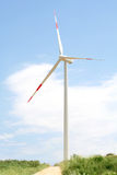 Wind turbine. Big Wind turbine on the blue sky Stock Image