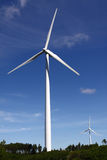 Wind turbine. A wind turbine in an open field in the hills Stock Images