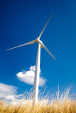 Wind turbine. On blue sky Royalty Free Stock Images