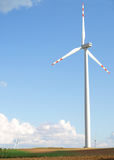 Wind Turbine. Single Wind turbine staying at field Royalty Free Stock Photography