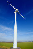 Wind turbine. Or mill is standing in a field where it catches the wind Stock Photo