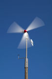 Wind turbine. On blue background Royalty Free Stock Photos