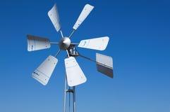Wind turbine. On blue background Royalty Free Stock Image