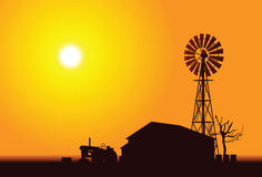 Wind Turbine. A silhouette of a old farmstead and a wind Turbine stock illustration