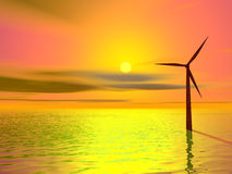 Wind turbine. Silhouetted against colourful sky Stock Photography