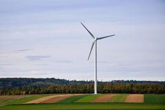 Wind turbine. In countryside with fields on autumn Stock Photography