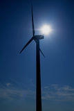 Wind turbine. In contre-jour with sun in back side, lens flare royalty free stock images