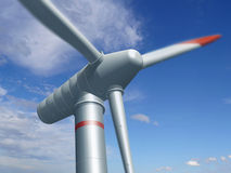 Wind turbine. Before blue sky Royalty Free Stock Photography