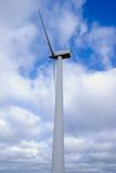 Wind turbine. On a background of the cloudy sky Stock Image