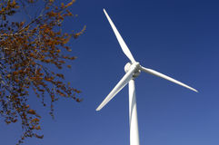 Wind Turbine. Over blue sky Royalty Free Stock Photo