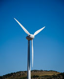 Wind turbine. On blue sky - environmentally friendly clean power Stock Images