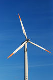 A wind turbine. Before blue Sky Royalty Free Stock Images