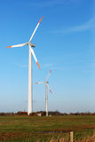 Wind turbine. S in green fields Royalty Free Stock Photography