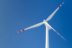 Wind turbine. Over blue sky royalty free stock photos