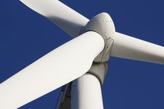 Wind-turbine. A wind-turbine against a clear blue sky stock image