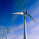 Wind turbine. 3d rendering of Wind turbines over the sea with a blue sky Stock Image