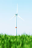 Wind turbine. In a green wheat field Royalty Free Stock Photos