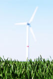 Wind turbine. In a green wheat field Royalty Free Stock Photography