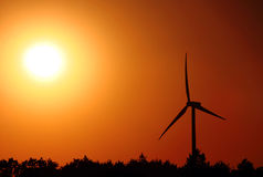 Wind turbine. For alternative energy in sunset Royalty Free Stock Images