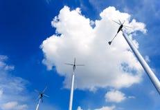 Wind turbine. On cloudy blue sky background Royalty Free Stock Photos