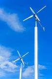 Wind turbine. On cloudy blue sky background Stock Photos