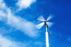 Wind turbine. On cloudy blue sky background Stock Image